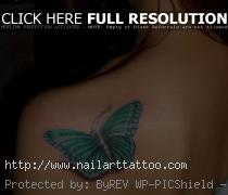Light Blue Butterfly Tattoo On Shoulder